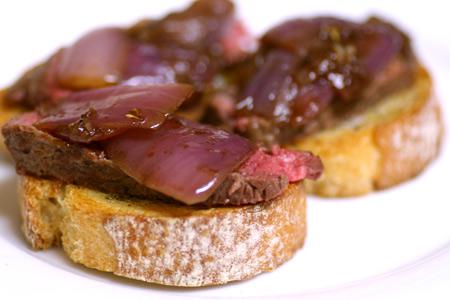 Bistecca with Balsamic-Roasted Onion Crostini