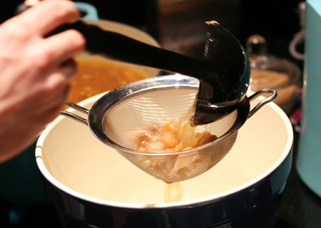 Straining the homemade chicken stock