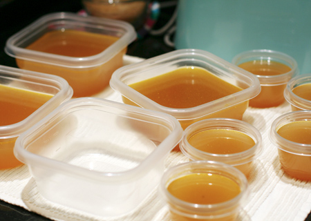 Divide the chicken stock into freezer-safe containers