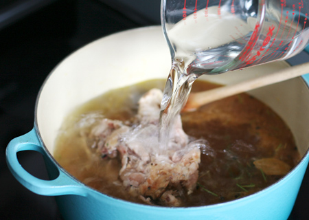 Add chicken carcass and water to stock pot