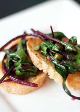 Beet Green and Garlic Scape Bruschetta