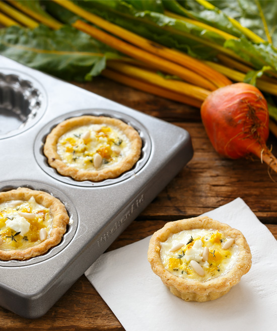 Bite-Sized Golden Beet and Goat Cheese Quiches from @loveandoliveoil