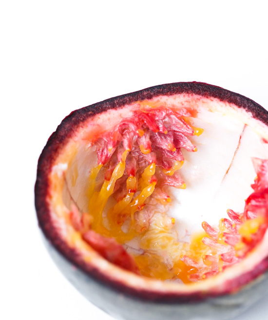The inside of a passion fruit