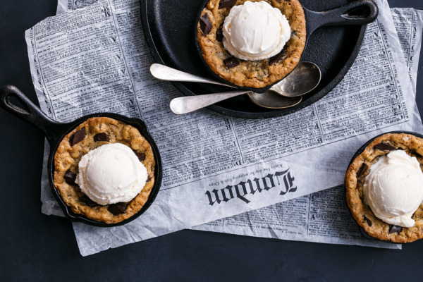 Mini Oatmeal Chocolate Chunk Skillet Cookies served a la mode with vanilla ice cream