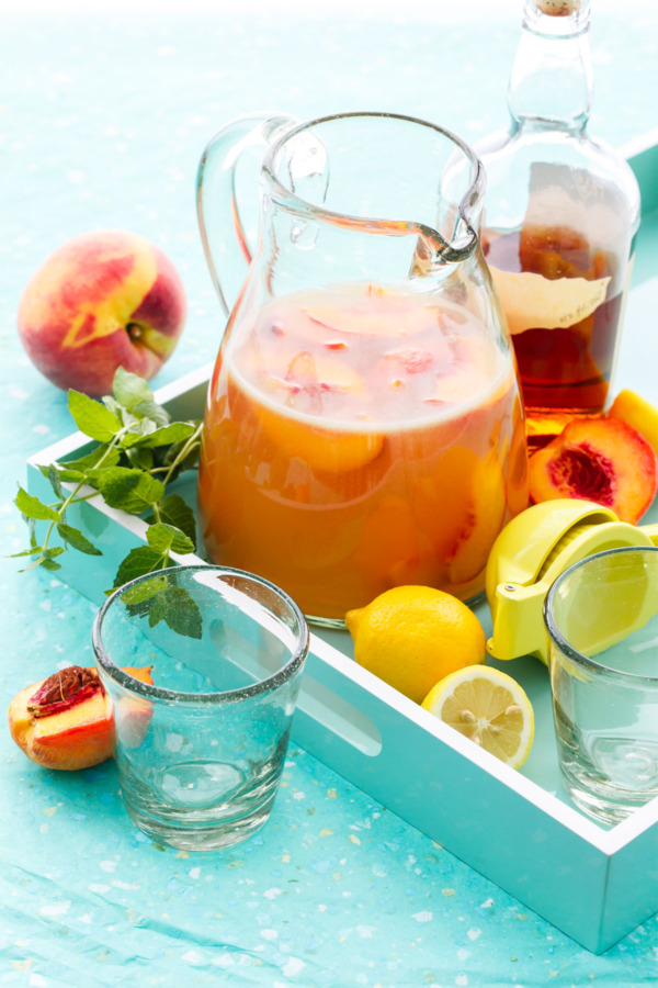 Bourbon Peach Lemonade Punch with fresh peaches and mint