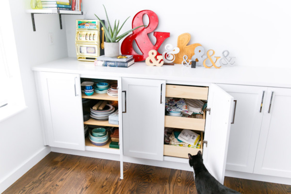 Townhouse Kitchen Remodel: Hidden pull outs for dishes and prop storage.