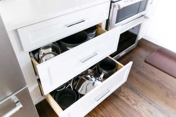 Townhouse Kitchen Remodel: Large cabinet drawers for pots and pans.