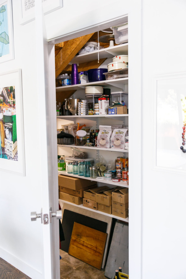 Townhouse Kitchen Remodel: Built-in pantry under the stairs.