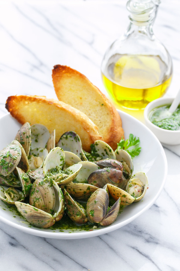 Mojo Clams steamed in garlic, olive oil, and white wine and tossed with a green 'mojo' sauce made with cilantro and parsley.