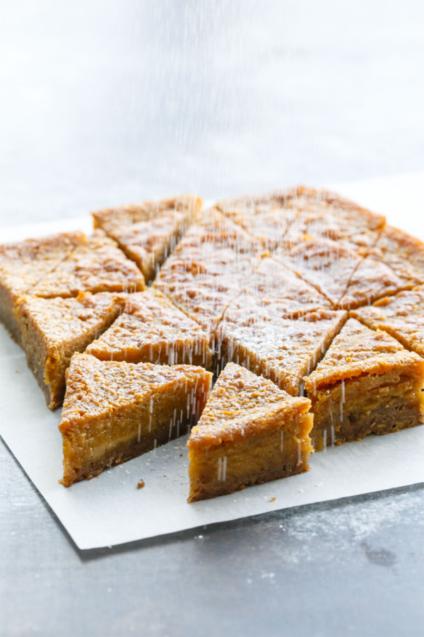 Pumpkin Chess Pie Bars topped with powdered sugar