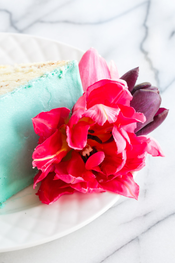 Cinnamon Swirl Layer Cake decorated with fresh flowers