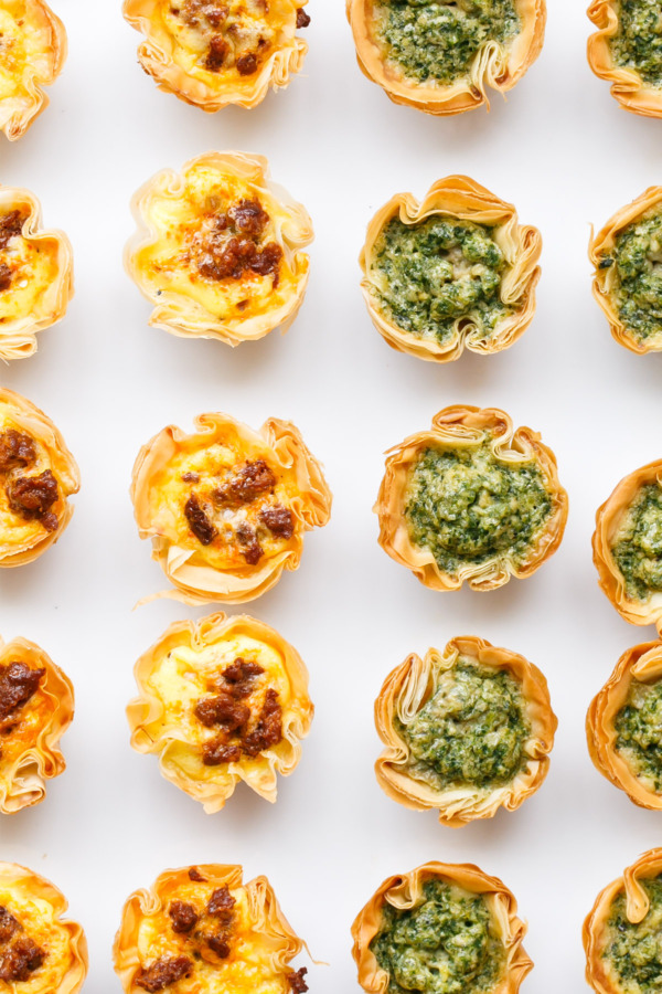 Mini Quiches made a perfect party appetizer, filled with any manner of add-ins including pesto or chorizo.