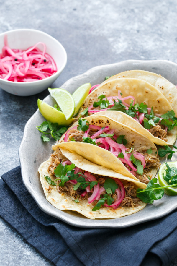 Slow-Cooker Pulled Pork Taco Recipe with Quick Pickled Onions on Top