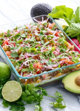 Mexican 7-Layer Dip with pickled jalapenos and cilantro lime guacamole