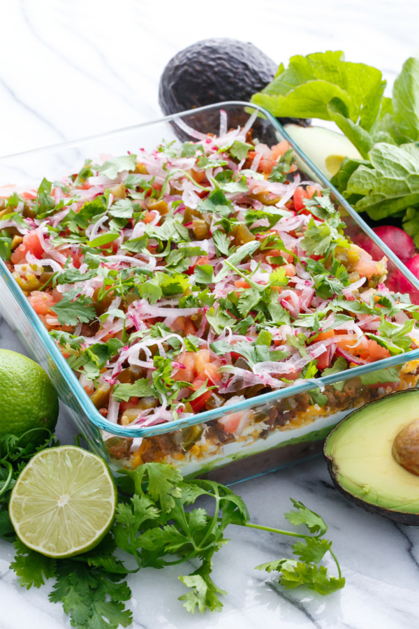 Mexican 7-Layer Dip with chorizo, pickled jalapenos and cilantro lime guacamole