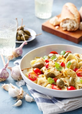 Looking for a quick & easy weeknight dinner recipe? Try this tortelloni with anchovies, capers, and cherry tomatoes!