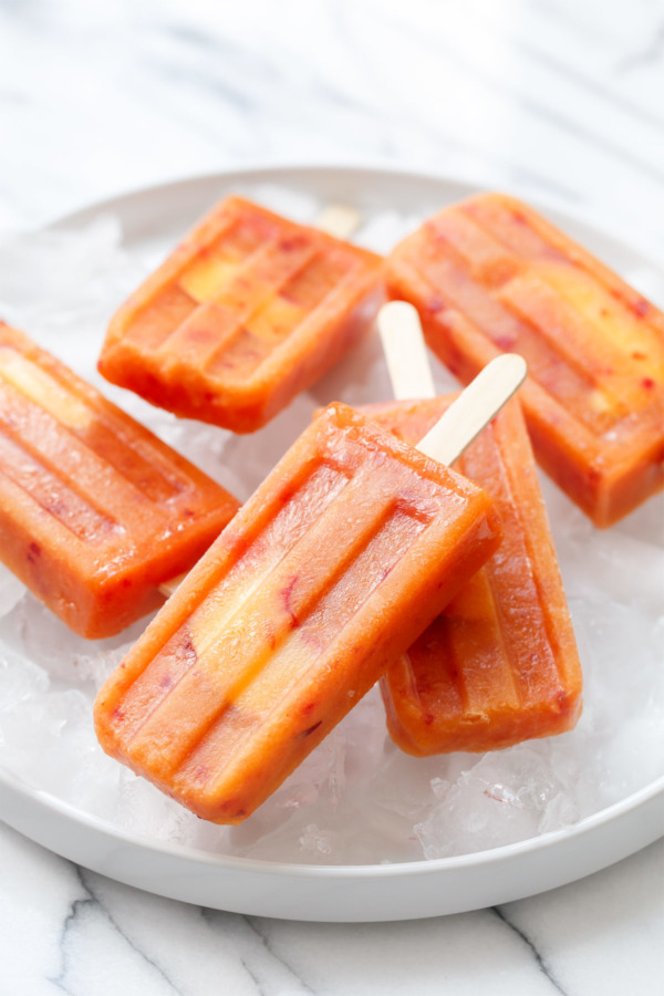 Grown up popsicles made with fresh peaches and rosé wine