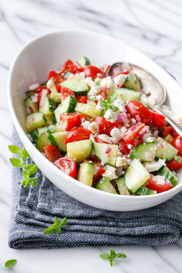 Cucumber and Tomato Salad ...How to manage the overwhelm of the glut of your tomato harvest -- Come take a look at all the great ideas for using up that tomato deliciously! Sign up to see our glut posts on zucchini and cucumbers, too.