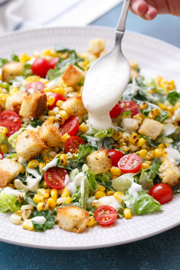 Chopped Salad with Romaine lettuce, chunky Blue Cheese dressing, Charred Corn, Cherry Tomatoes, and Homemade Croutons