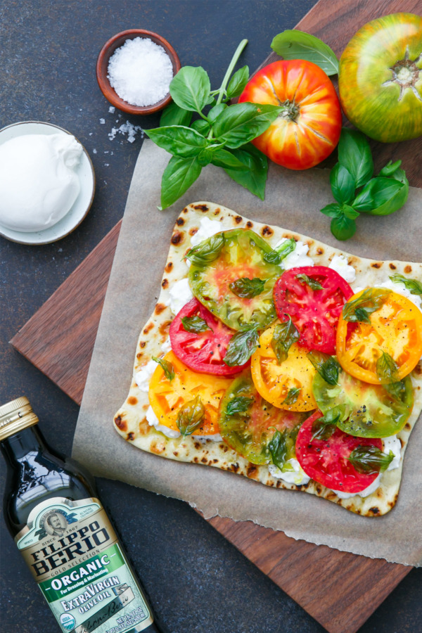 Heirloom Tomato Flatbread with Fried Basil, Burrata, and Extra Virgin Olive Oil
