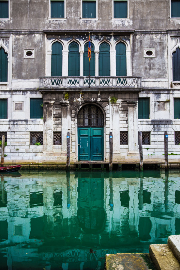 Weathered buildings and turquoise canals in Venice, Italy