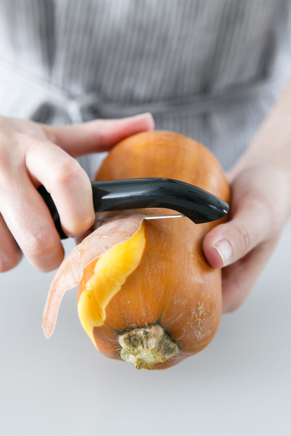 Peeling Honeynut squash before roasting