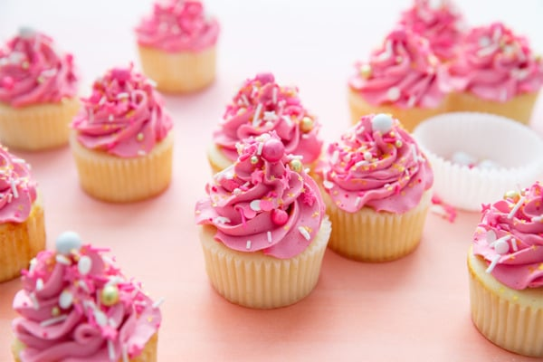 Sprinkle-Filled Fluffy White Cupcakes with Marshmallow Buttercream