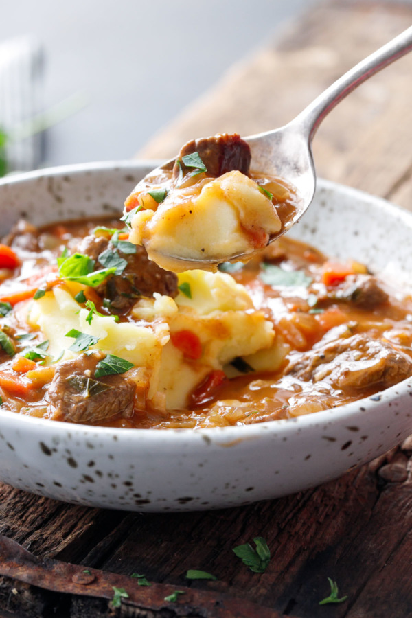 Hearty Beef Stew served over Creamy Mashed Potatoes (Like Shepherd's Pie, in stew form!)