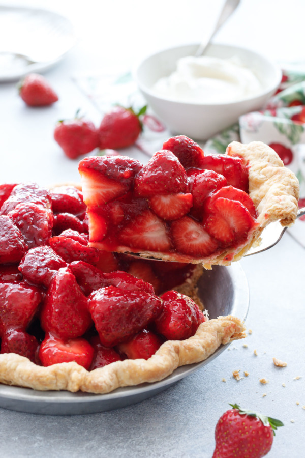 A perfect slice of Fresh Strawberry Rose Pie with ultra-flaky crust. Just add freshly whipped cream!