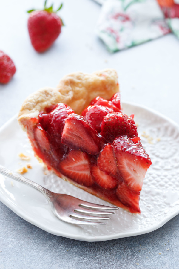 The perfect slice of strawberry pie, made with fresh strawberries and a hint of rosewater.