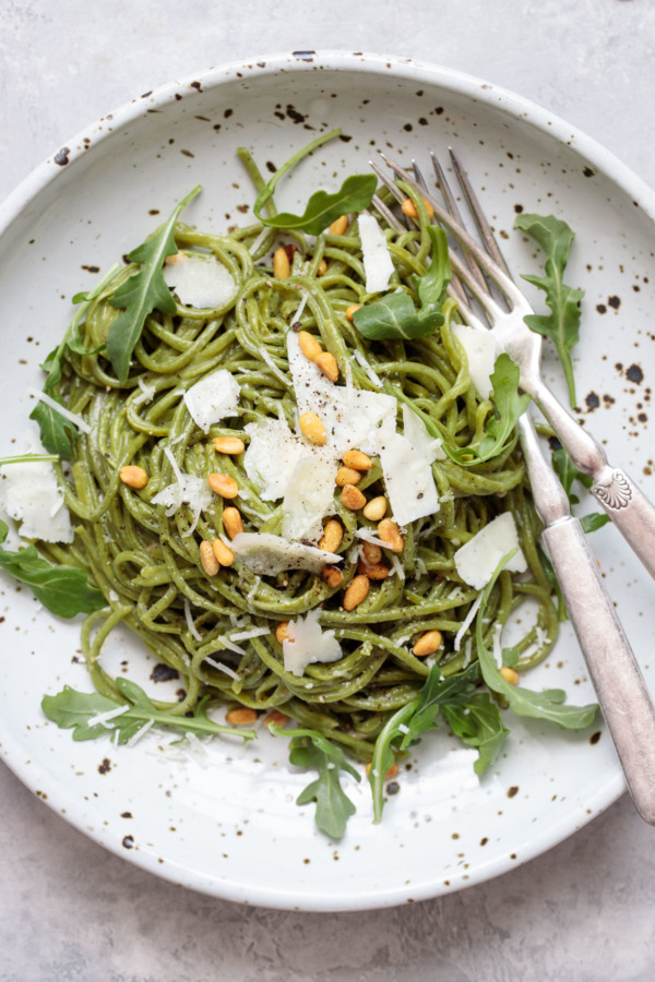 Arugula Cacio e Pepe with Pecorino cheese and toasted pine nuts