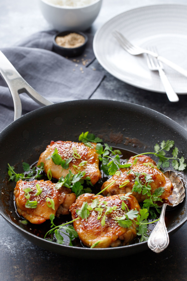 Honey Sriracha Chicken Thighs topped with cilantro and green onion
