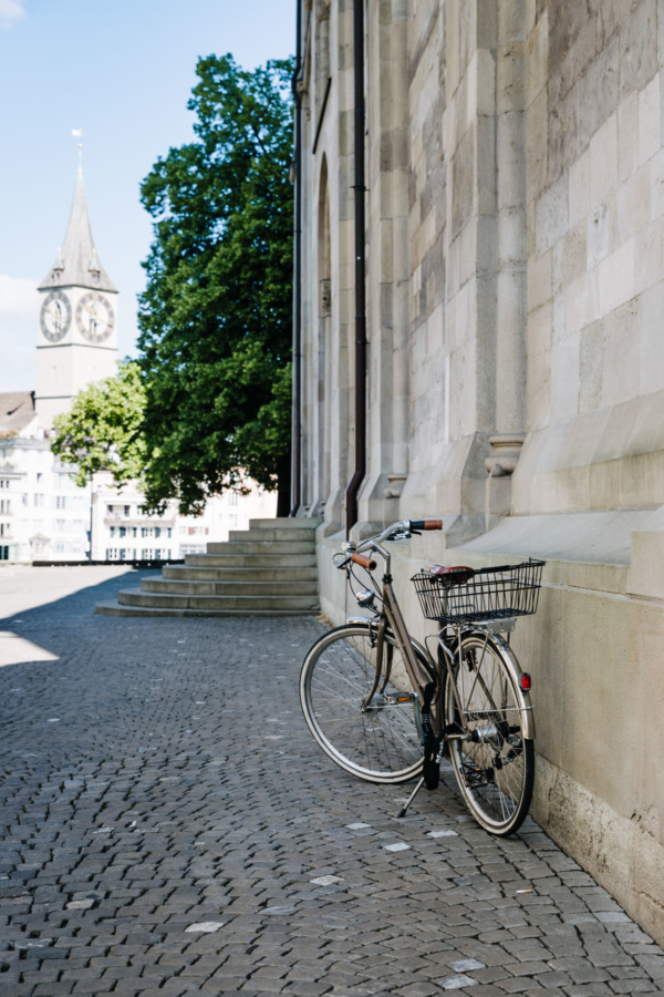 Bike leaning up against Grossmünster church, Zurich, Switzerland