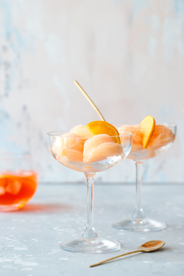Boozy spritz sorbet recipe, with aperol, prosecco and orange juice.