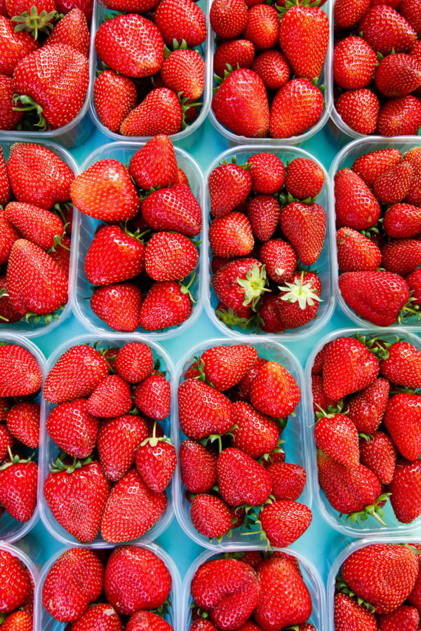 Fresh strawberries at a farmers' market in Montreuil-Bellay, France
