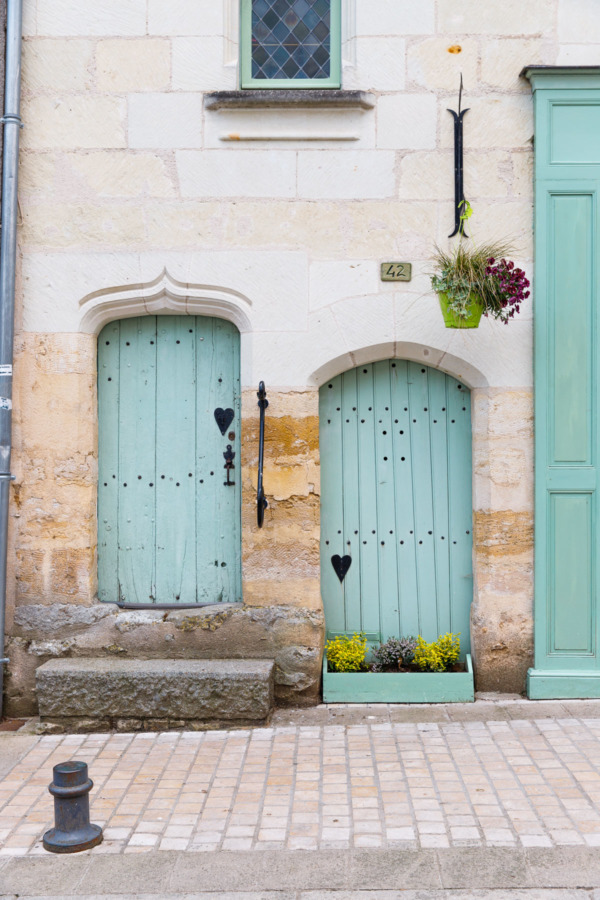 Charming mint green doors in Montreuil-Bellay, France