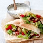 Yogurt-marinated Chicken served in a soft pita bread with yogurt Caesar dressing