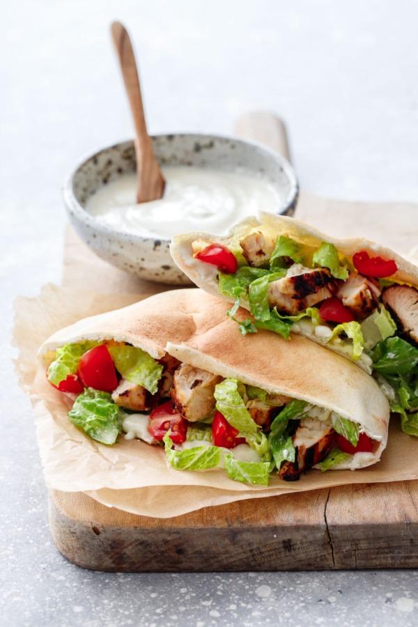 Yogurt-marinated Chicken served in a soft pita bread with yogurt Caesar dressing