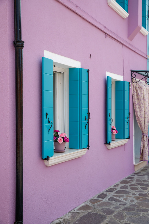 Purple house, blue shutters in Burano, Italy