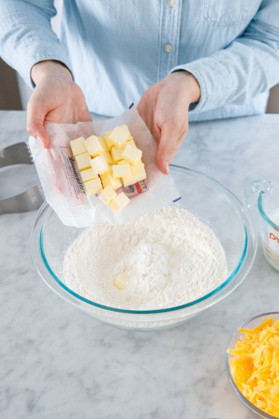 How to make buttermilk biscuits from scratch: add cubes of COLD butter to your flour mixture.