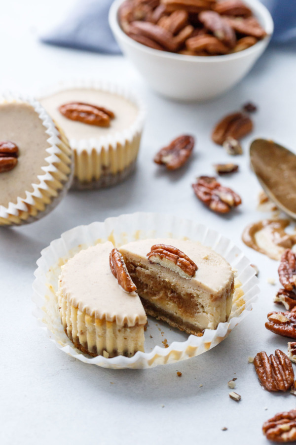 Mini Pecan Praline Cheesecakes with white chocolate gianduja topping