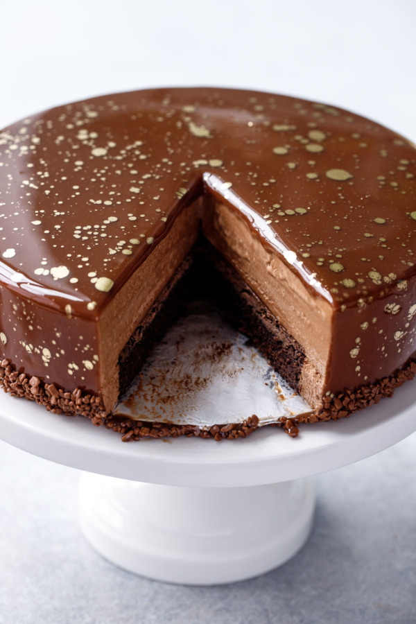 The chocolate mirror glaze makes this mousse cake extra impressive, a perfect holiday dessert recipe!