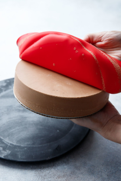 A silicone cake pan makes a perfectly smooth surface.