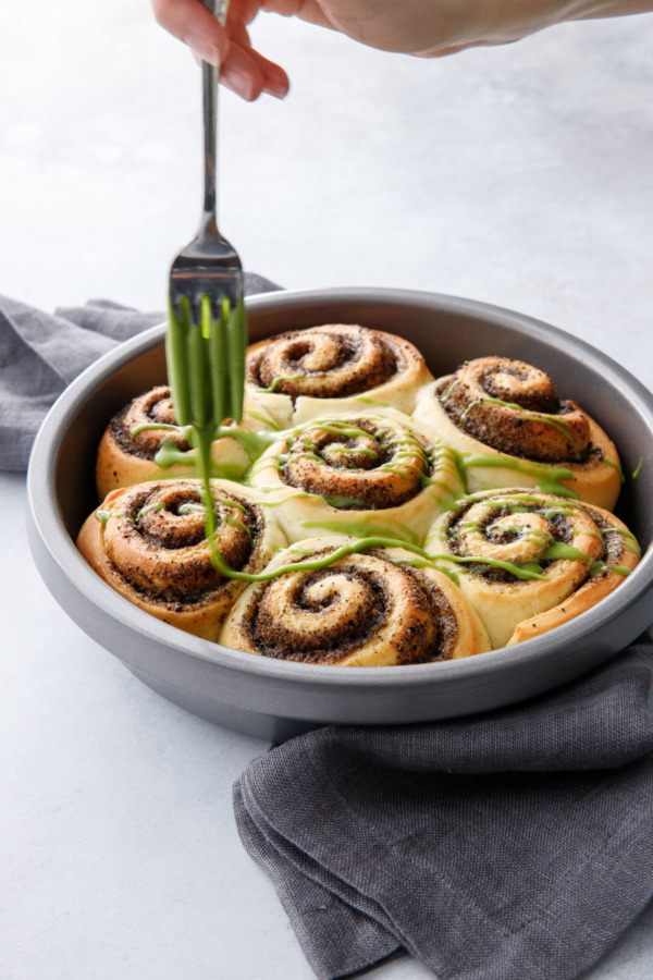 Black Sesame Cinnamon Rolls drizzled with a sweet matcha glaze