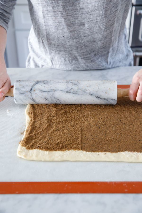 Use a rolling pin to compress the filling.