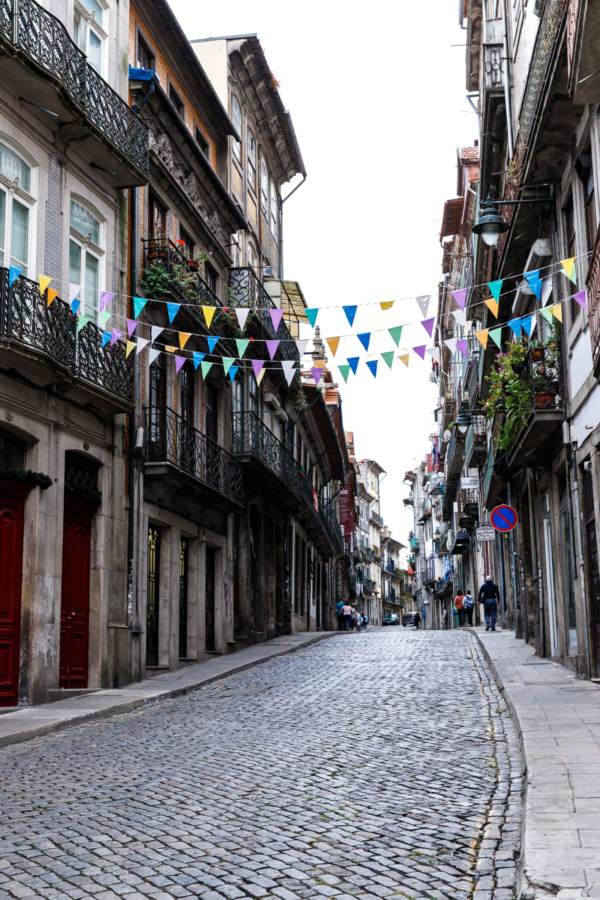 Cobbled street and colorful bunting, Porto, Portugal