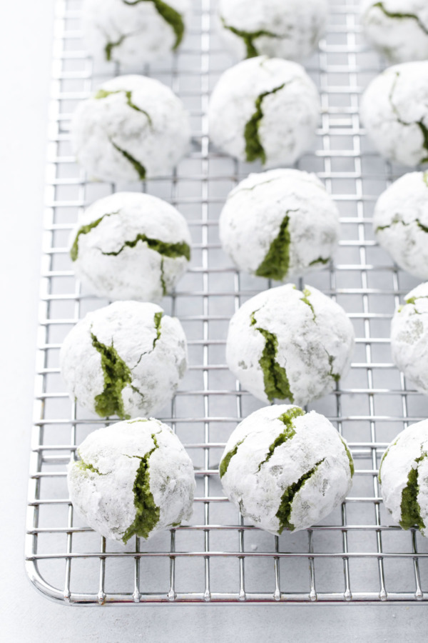 Matcha Amaretti Cookies covered with powdered sugar