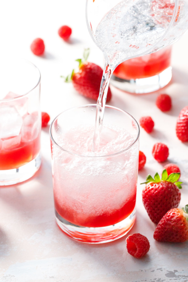 Top a homemade fruit shrub with sparking soda for a unique and flavorful mocktail recipe!