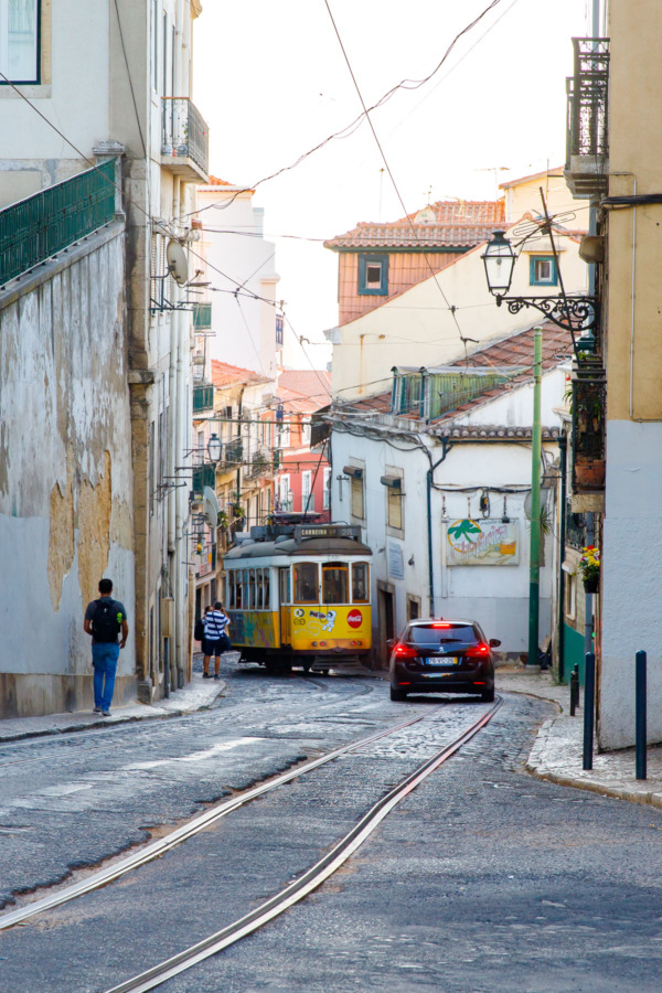 The historic 28E tram in Lisbon, Portugal winds its way through the narrow streets.