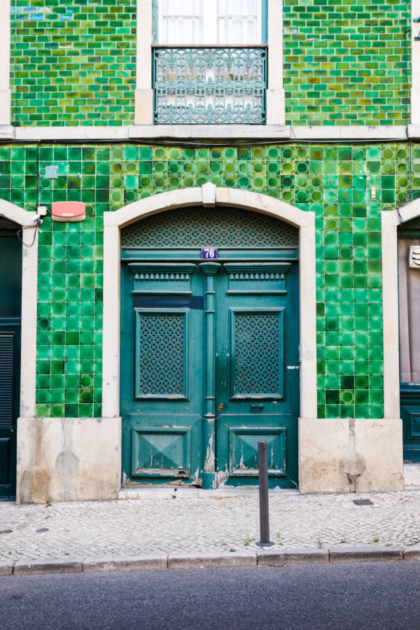 Green tiled facade in the Barrio Alto district of Lisbon, Portugal